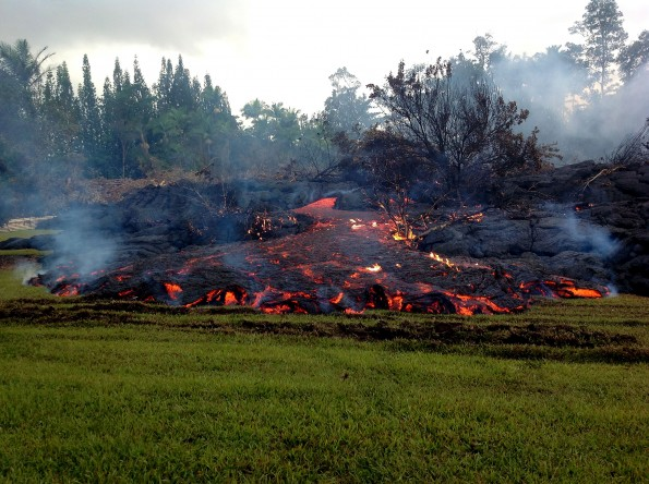 A breakout occurs from an inflated lobe of the June 27th lava flow on Sunday morning, November 2, 2014. Scattered breakouts like this, which took place about 200 meters (218 yards) upslope of the stalled leading edge, have been common over the past few days and are filling in low points behind the flow front. Photo courtesy of USGS/HVO