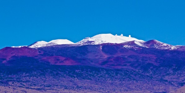 Mauna Kea snow seen from the Daniel K. Inouye Highway Sunday, January 4, 2014. Photography by Baron Sekiya | Hawaii 24/7