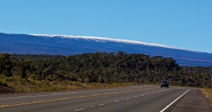 The snow-capped Mauna Loa and the Daniel K. Inouye Highway Sunday, January 4, 2014. Photography by Baron Sekiya | Hawaii 24/7