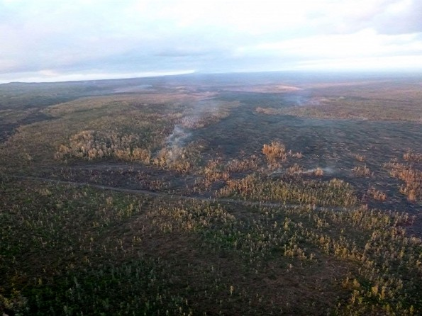 The Kilauea June 27th Lava Flow looking upslope past the firebreak Wednesday morning, February 18, 2015. Photo courtesy of Hawaii County Civil Defense