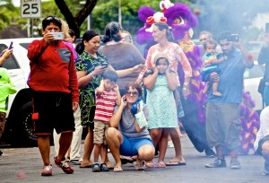 The crowd watches fireworks along with lion dancers, percussion music and a firebreather in downtown Hilo Chinese New Year's celebration. Photography by Baron Sekiya | Hawaii 24/7