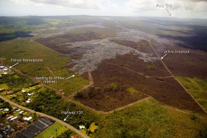 The leading tip of the June 27th lava flow remains stalled, but breakouts persist upslope of the stalled tip. Today, one of these breakouts (marked by the arrow) had advanced a short distance towards the north, reaching one of the fire break roads. Photo taken Monday, February 23, 2015 courtesy of USGS/HVO