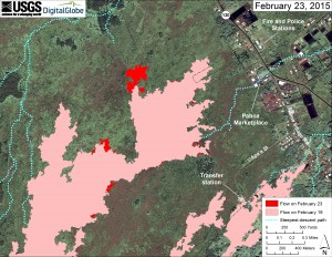 This large-scale map uses a satellite image acquired in March 2014 (provided by Digital Globe) as a base to show the area around the front of Kīlauea's active East Rift Zone lava flow. The area of the flow on February 19 is shown in pink, while widening and advancement of the flow as of February 23 is shown in red. The blue lines show steepest-descent paths calculated from a 1983 digital elevation model (DEM; for calculation details, see http://pubs.usgs.gov/of/2007/1264/). Steepest-descent path analysis is based on the assumption that the DEM perfectly represents the earth's surface. DEMs, however, are not perfect, so the blue lines on this map can be used to infer only approximate flow paths.