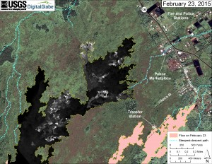 This map overlays a georegistered mosaic of thermal images collected during a helicopter overflight of the distal part of Kīlauea's active East Rift Zone lava flow on February 23 at about 12:30 PM. The base image is a satellite image acquired in March 2014 (provided by Digital Globe). The perimeter of the flow at that time is outlined in yellow. Temperature in the thermal image is displayed as gray-scale values, with the brightest pixels indicating the hottest areas (white shows active breakouts). The blue lines show steepest-descent paths calculated from a 1983 digital elevation model (DEM; for calculation details, see http://pubs.usgs.gov/of/2007/1264/). Steepest-descent path analysis is based on the assumption that the DEM perfectly represents the earth's surface. DEMs, however, are not perfect, so the blue lines on this map can be used to infer only approximate flow paths.