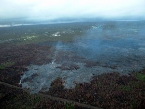 Photo from the Tuesday morning (Feb 24) overflight showing the north margin breakout. This photo is looking downslope with Pahoa in the background. Photo courtesy of Hawaii County Civil Defense