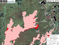 This large-scale map uses a satellite image acquired in March 2014 (provided by Digital Globe) as a base to show the area around the front of Kīlauea's active East Rift Zone lava flow. The area of the flow on February 27 is shown in pink, while widening and advancement of the flow as of March 10 is shown in red. The blue lines show steepest-descent paths calculated from a 1983 digital elevation model (DEM; for calculation details, see http://pubs.usgs.gov/of/2007/1264/). Steepest-descent path analysis is based on the assumption that the DEM perfectly represents the earth's surface. DEMs, however, are not perfect, so the blue lines on this map can be used to infer only approximate flow paths.