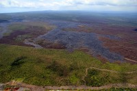 As reported since March 12, the leading edge just upslope of the Pahoa Marketplace, is inactive. The active breakouts noted Tuesday, March 17, 2015 were more than 14 km (8.7 mi) straight-line distance from the Marketplace. Photo courtesy of USGS/HVO