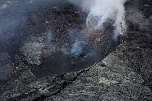 There are several incandescent and outgassing hornitos on the floor of Puʻu ʻŌʻō's crater, including the one shown here, which is at the northeast edge of the crater. Recent flows from the hornito appear black. Photo taken Tuesday, March 24, 2015 courtesy of USGS/HVO