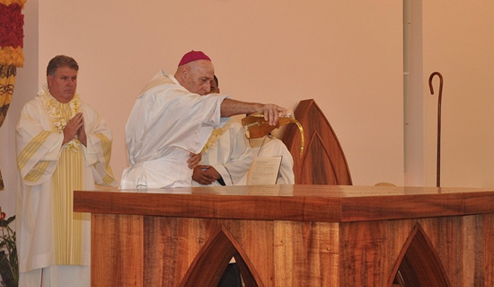 Bishop Silva anoints the new altar. (Photo courtesy of St. Michael the Archangel Church)