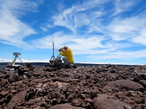 An HVO geologist performs a routine check of the thermal camera and webcam at the summit of Mauna Loa. Photo taken Saturday, September 19, 2015 courtesy of USGS/HVO