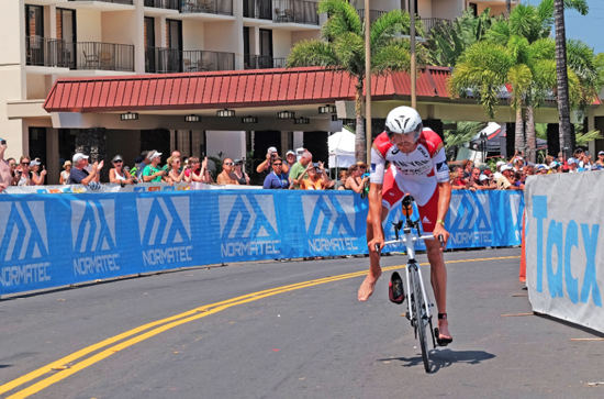 Jan Frodeno of Germany finishes first in the 112-mile (180.25 km) bicycle ride during the Ironman World Championship on Oct. 10 2015, Kailua Kona, Hawaii. (Photo by Jason Rappaport/IRONMAN)