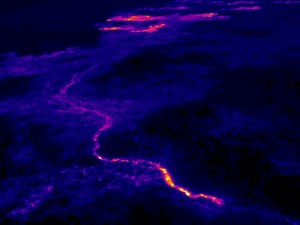 The breakout that began in late November continues to feed lava to the northern boundary of the flow field via a new lava tube. The trace of this new tube is easily visible in the thermal images. This view looks northeast, and the breakouts along the forest boundary are visible near the top edge of the photograph. Photo taken Wednesday, December 30, 2015 courtesy of USGS/HVO