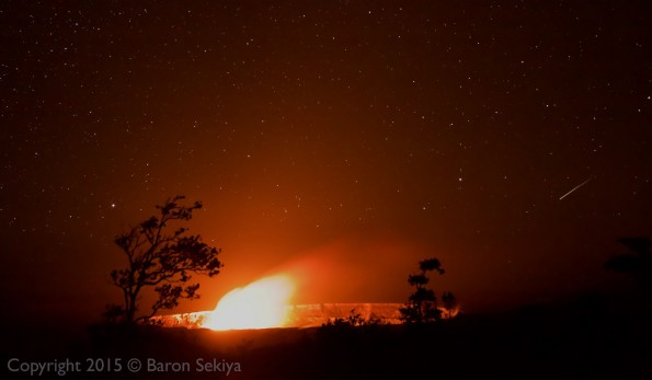 Kilauea Caldera with the glow from the active lava lake in Halemaumau's Overlook Crater as a shooting star cuts across the sky on the right. Monday, January 4, 2016. Photo by Baron Sekiya | Hawaii 24/7