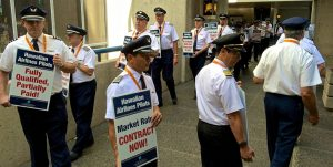Hawaiian Airlines pilots and other supporters conducted informational picketing outside Honolulu International Airport Wednesday, March 16, 2016. Photography by Baron Sekiya | Hawaii 24/7