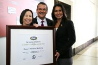 (Left to right) HTA Director of Communications Charlene Chan; HTA President and CEO George Szigeti; Rep. Tulsi Gabbard