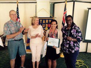 Hilo Bay Rotarians congratulate Jyselle Arruda on her scholarship award. Left to right, Richard Cunningham, Kim Keahiolalo, Arruda and Bettye Williams, RCHB president.