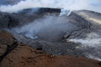 Puʻu ʻŌʻō's current crater subsided by about 10 m (33 ft) in the days following the May 24 breakouts. This view, looking southeast, shows the crater as it was today. HVO webcams are perched on the edge of the Puʻu ʻŌʻō cone (an older crater rim) in the foreground. Photo taken Thursday, June 2, 2016 courtesy of USGS/HVO