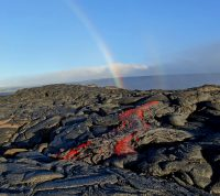 A faint double rainbow provided a beautiful backdrop for sluggish pāhoehoe lava oozing out from near the flow front this morning. Photo taken Friday, July 22, 2016 courtesy of USGS/HVOThe flow was about 615m from the road and 760 m from the ocean.