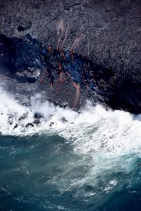 A close-up view of the ocean entry with multiple small fingers of lava spilling over the cliff. Photo taken Tuesday, July 26, 2016 courtesy of USGS/HVO