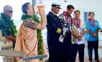 Kahu Kaliko Trapp, St. Joseph Catholic Church, sounds a conch shell during the dedication ceremony of the new fire station at Hilo International Airport Friday, July 29, 2016. Photography by Baron Sekiya | Hawaii 24/7