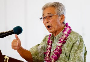 Representative Clift Tsuji speaking on behalf of the Speaker of the House of Representatives Joseph Souki during the dedication ceremony of the new Hilo International Airport Aircraft Rescue and Firefighting Station Friday, July 29, 2016.