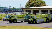 Firefighting vehicles at Hilo International Airport in their old facility. The vehicles will be housed in the new $18.8M facility which was built to accommodate even larger sized vehicles. Photography by Baron Sekiya | Hawaii 24/7