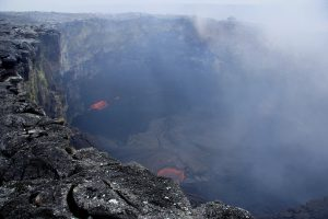 View of the lava pond within the Puʻu ʻŌʻō west pit crater, which is about 50 m (164 ft) across. Weak spattering on the lava pond surface, about 23 m (75 ft) below the crater rim, is visible through the thick volcanic gas cloud. Photo taken Thursday, September 1, 2016 courtesy of USGS/HVO