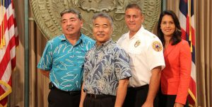 Deputy Police Chief Paul Ferreira, Gov. David Ige, Fire Chief Darren J. Rosario, Rep. Tulsi Gabbard in Honolulu at the launch of the Text-to-911 service. Photo courtesy Office of the Governor.