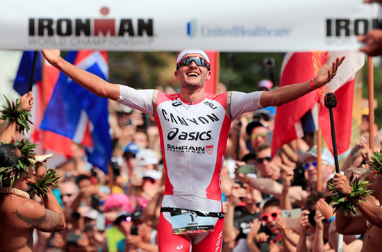 Jan Frodeno celebrates as he crosses the finish line. (Photo courtesy of Ironman)