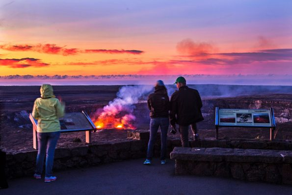 Visitors observe the lava lake within Halema'uma'u Crater from the Jaggar Museum observation deck at dawn. Photo courtesy of NPS Photo/Janice Wei
