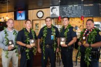 Major Mitchell Kanehailua congratulates West Hawaiʻi Officers Adam Roberg, Kimo Keliipaakaua, Chandler Nacino and Severo Ines.