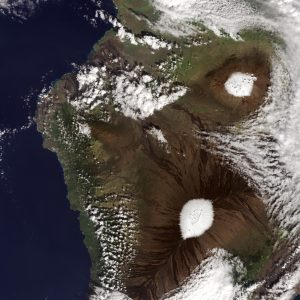The snow-capped summits of Mauna Kea (top) and Mauna Loa (bottom) on December 25, 2016. NASA Earth Observatory images by Jesse Allen, using Landsat data from the U.S. Geological Survey.