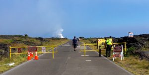 Visitors begin the five-mile hike to Kamokuna shortly after the park opened the lava viewing area on Tuesday, January 3. Today marks the 34th anniversary of the eruption of Pu'u 'Ō'ō vent on Kīlauea, the source of the lava flows going into the ocean today. NPS Photo/Janice Wei