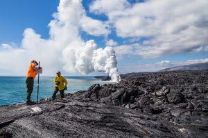Eruption Crew Rangers work on establishing rope line marking closure at coastal cliffs. NPS Photo taken Monday, January 2, 2017.