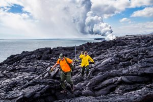 Eruption Crew Rangers Rob Ely and John Moraes replace white rope line marking closed coastal cliffs. NPS Photo taken Monday, January 2, 2017.