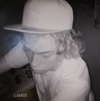 Surveillance image of second burglary suspect