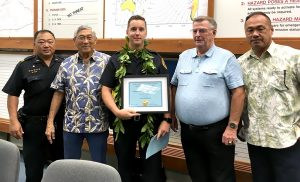 Pictured from left to right: Captain Randall Ishii, Mayor Harry Kim, Officer Tyler Prokopec, Bill King of Securitas, and Wesley Taketa of Royal Kona Resort