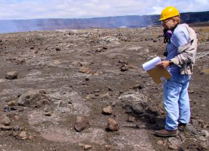 """Ben Gaddis, a volunteer at the USGS Hawaiian Volcano Observatory, works on historical documentation of volcanic products from the 1924 explosive eruption of Halemaʻumaʻu Crater within Kīlauea's summit caldera. Ben recently received the U.S. Department of Interior's """"Citizen's Award for Exceptional Service"""" for his many years of volunteer service at HVO. USGS photo."""