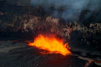 Spattering is common in the summit lava lake in Halema'uma'u Crater. This afternoon, spattering was active at a site along the east lake margin. Spatter deposits have built a small ledge extending out from the crater walls (lower right of photo), onto which fluid spatter often falls. For scale, the lake surface is 28 meters (92 feet) below the floor of Halema'uma'u Crater (visible at the top of the photo). Photo taken Tuesday, July 11, 2017 courtesy of USGS/HVO