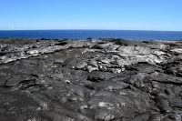 A view of the breakout point of the easternmost of two short-lived breakouts that began on September 23. This thin pāhoehoe breakout (lighter flow in center of photo) started approximately 45 m (49 yards) upslope of the sea cliff, and on the eastern side of the lava tube that feeds the ocean entry. This breakout stopped just before it reached the edge of the sea cliff. Photo taken Tuesday, September 26, 2017 courtesy of USGS/HVO