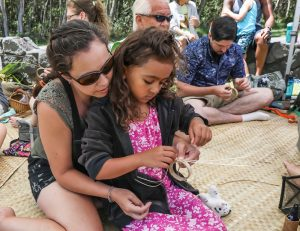 A youngster learns to weave lau hala bracelet at the 2017 Cultural Festival. NPS Photo/Janice Wei