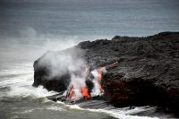 The episode 61g Kamokuna ocean entry was still active today (October 26), with a breakout on the delta surface feeding multiple lava streams on the delta's seaward edge. Despite the amount of lava entering the water, the ocean entry plume was extremely weak, with little to no sign of it from HVO's Holei Pali webcam (HPcam), which views the lower half of the 61g flow field, from the ocean entry to the pali. Photo taken Thursday, October 26, 2017 courtesy of USGS/HVO
