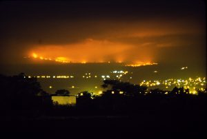 Glow from a Mauna Loa lava flow lit up the night sky above Hilo on April 4, 1984. In this photo, captured from near the Hilo airport, the flow front appears closer to the city than it actually was. Should a similar eruption occur in the future, the U.S. Geological Survey's lava flow inundation maps could help alleviate concern for residents outside the identified inundation zone for a given flow. Photo courtesy of David Little.