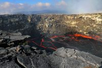 The lava pond in the west pit of Pu'u 'Ō'ō remains active. While at Pu'u 'Ō'ō making observations, HVO geologists witnessed a small rockfall from the western wall (center right of photo where spattering is occurring). The rockfall briefly disturbed the pond surface and produced spattering for several minutes. Rockfalls into the lava pond are fairly common because the unstable west pit rim and walls have many loose altered rocks, overhung ledges, and cracks (example at left center). Photo taken Wednesday, November 1, 2017 courtesy of USGS/HVO
