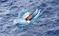 The overturned 57-foot fishing vessel Jane, 110 miles southeast of Hawaii Island, Hawaii, Nov. 27, 2017. The six fishermen on board were rescued by the crew of the 70-foot fishing vessel VAK 2 and will be taken back to Hawaii where they will be met by emergency medical services and U.S. Customs and Border Protection. (U.S. Coast Guard photo/Released)