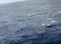 Six fishermen from the 57-foot fishing vessel Jane, reportedly taking on water 110 miles southeast of Hawaii Island, Hawaii, Nov. 27, 2017. The six fishermen evacuated from the boat and boarded this raft. (U.S. Coast Guard photo/Released)