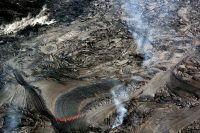 Active lava breakouts were scarce across the episode 61g flow field on Kīlauea Volcano's East Rift Zone, with active flows confined to an area approximately 1–2 km (0.6–1.2 miles) from Pu'u 'Ō'ō. This breakout from the lava tube consisted of fluid pāhoehoe. Photo taken Tuesday, March 27, 2018 courtesy of U.S. Geological Survey