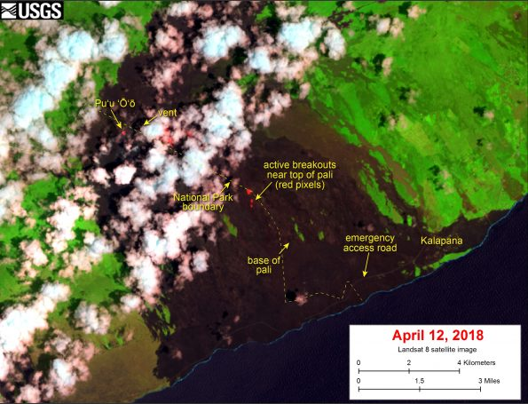 This satellite image was captured on Thursday, April 12, by the Landsat 8 satellite. Although this is a false-color image, the color map has been chosen to mimic what the human eye would expect to see. Bright red pixels depict areas of high temperatures and show active lava. White areas are clouds.   The image shows that breakouts continue in several areas on the flow field. The largest breakout is in the upper flow field, about 1 km (0.6 miles) east of Pu'u 'Ō'ō. The closest breakouts to the coast include a few small areas that are active near the top of the pali.