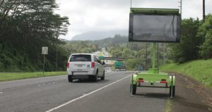 The message board on Kamehameha Highway near the Hawaiian Memorial Park Cemetery will provide Honolulu bound travelers with Pali Highway travel times which will help determine if it is better to take the H-3 Freeway (the message is not displayed in the photograph). Photo courtesy HDOT
