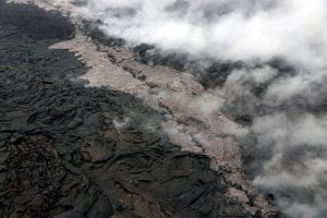 Telephoto view of a small lava flow (lighter in color) and spatter (blue-gray) that were erupted from a section of the crack on the west flank of Pu'u 'Ō'ō. Photo taken Tuesday, May 1, 2018 courtesy of U.S. Geological Survey